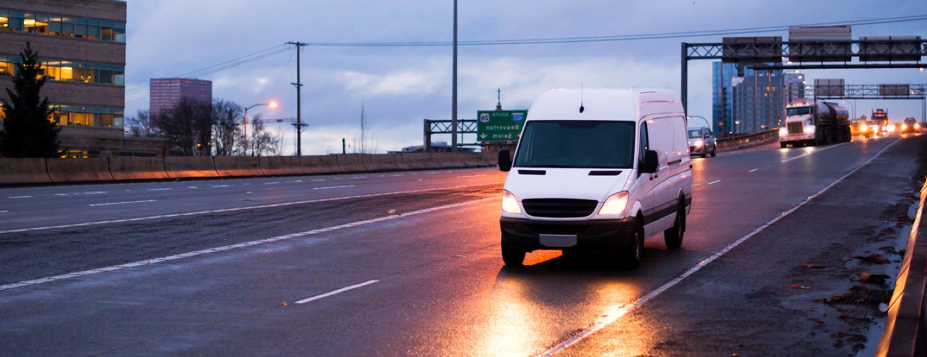white van running on the road