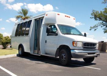 white van parking in a parking lot